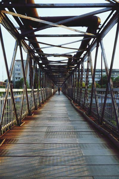 Resist Resist! Train Passage Long Way Blocks Bridge - Man Made Structure Lifestyles Travel Destinations Outdoors City Footbridge