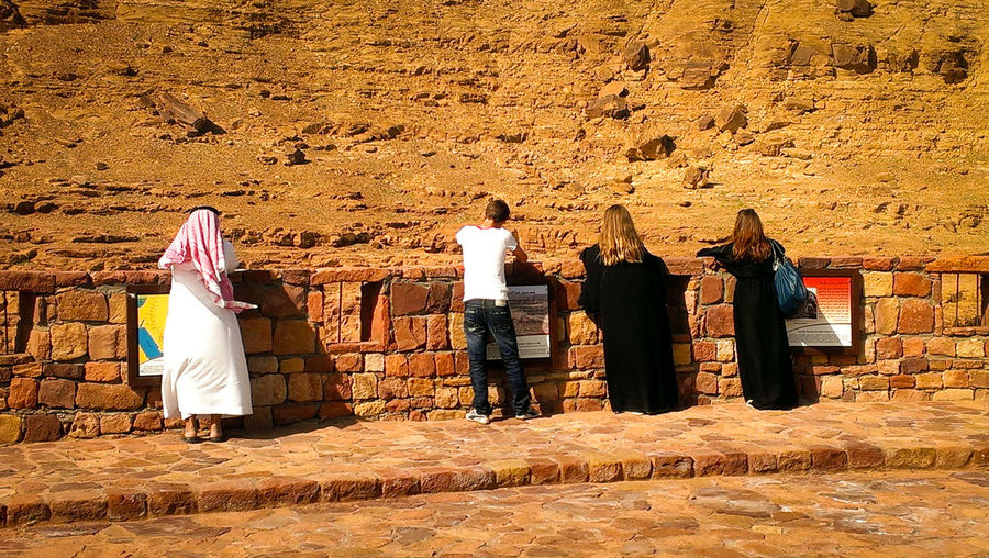 Back Check This Out Day Desert Eyeemphoto Eyeemphotography Four From Behind Full Length In A Row Outdoors Person Person From The Back Saudi Arabia Standing Stones Togetherness Tranquility Two And Two Two Is Better Than One Vacations