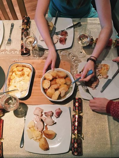 Food And Drink High Angle View Food Eating Table Plate Christmas Dinner Potatoes Crackers Human Hand