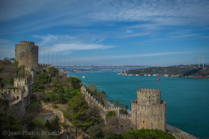 The breathtaking Rumeli Hisarı on the majestic Bosphorous, separating Europe from Asia in Istanbul, Turkey. Istanbul Turkey Rumeli Hisarı Bridge Castle Clouds Cityscape Architecture Bosphorous Boaz
