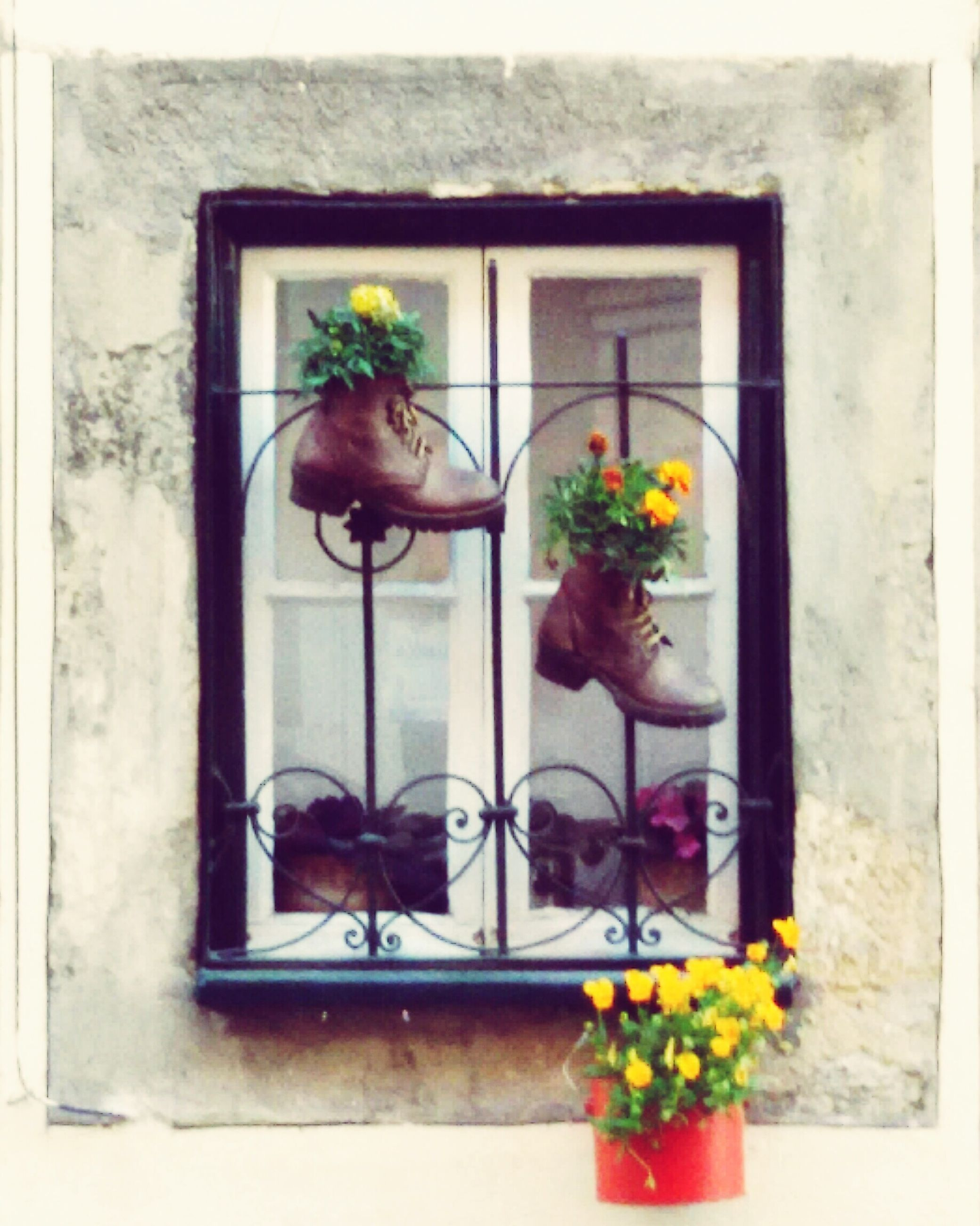 human representation, flower, art and craft, art, potted plant, window, creativity, animal representation, indoors, sculpture, statue, decoration, plant, built structure, vase, wall - building feature, architecture, wall