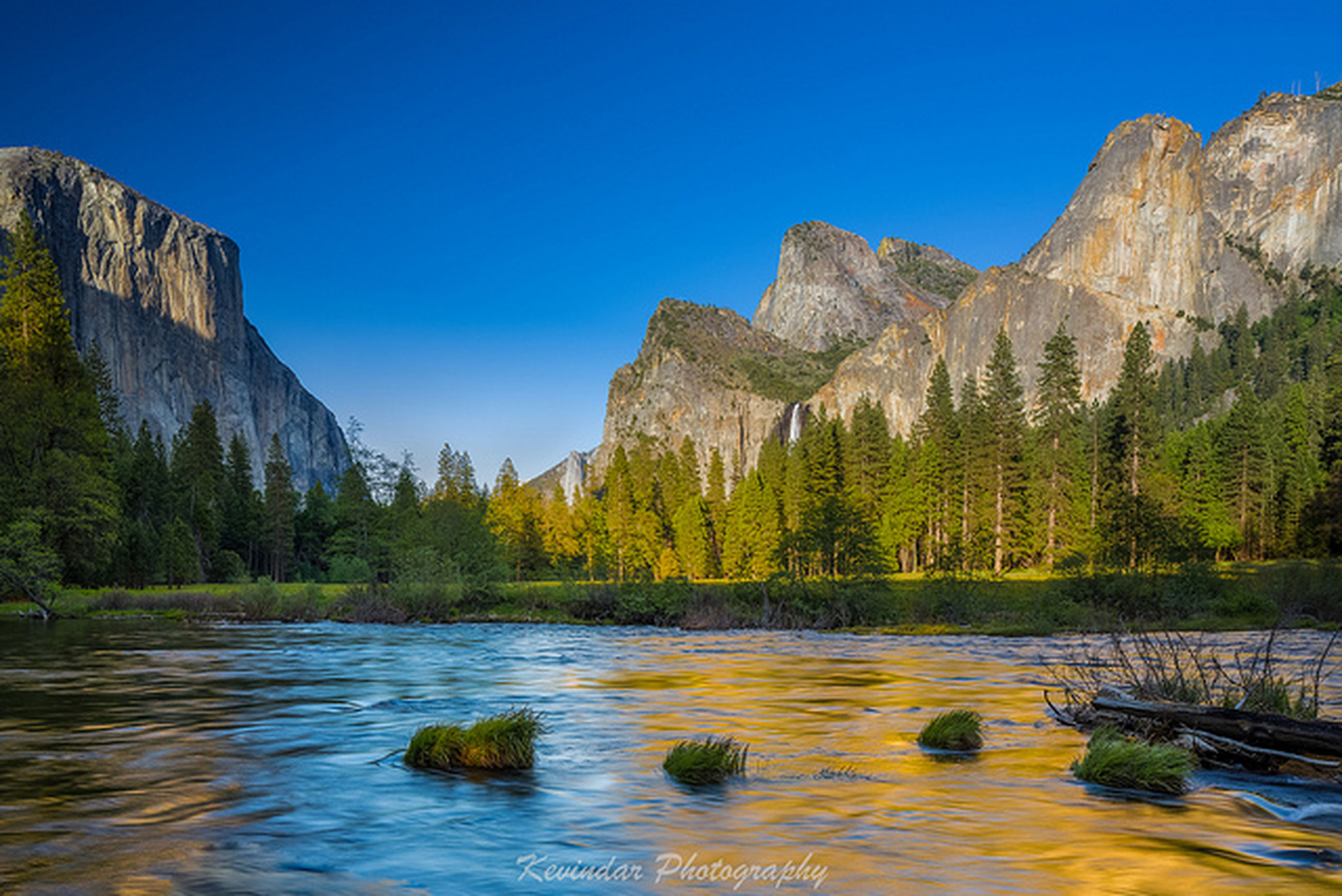 water, clear sky, mountain, tranquil scene, tranquility, scenics, beauty in nature, rock formation, nature, rock - object, blue, lake, waterfront, cliff, rocky mountains, idyllic, tree, river, rock, reflection