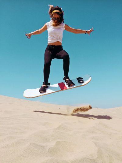 Full length of man jumping on beach
