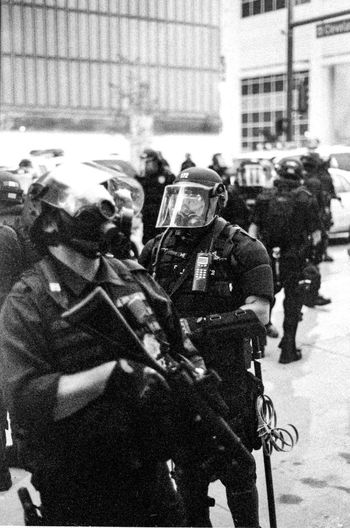 Protests at the 2008 Democratic National Convention (DNC) 2008 Democratic National Convention Black & White Film Gun Protest Ar-15 Black And White Black And White Photography Blackandwhite Blackandwhite Photography Civil Disturbance Film Photography Firearms Police Police Force Protesters Rifle Riot Police Tri-x 400 Pushed