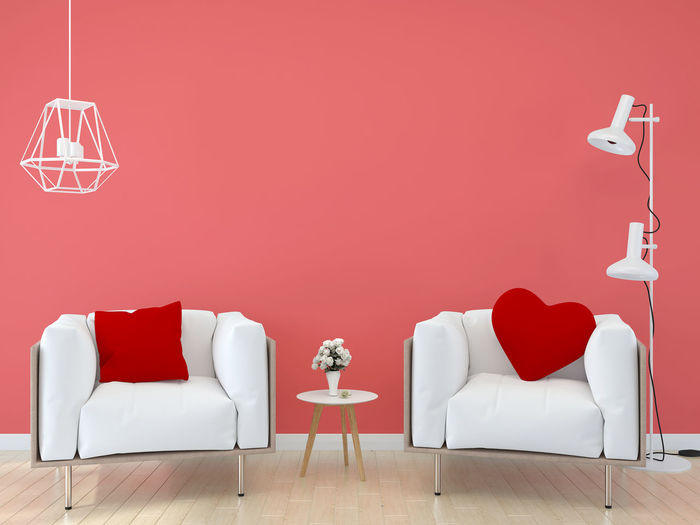 Red chairs and table against wall at home