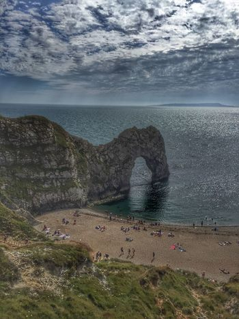 Sea Nature Beauty In Nature Horizon Over Water Sand Beach Water Scenics Sky Day Outdoors Cloud - Sky Real People Durdle Door