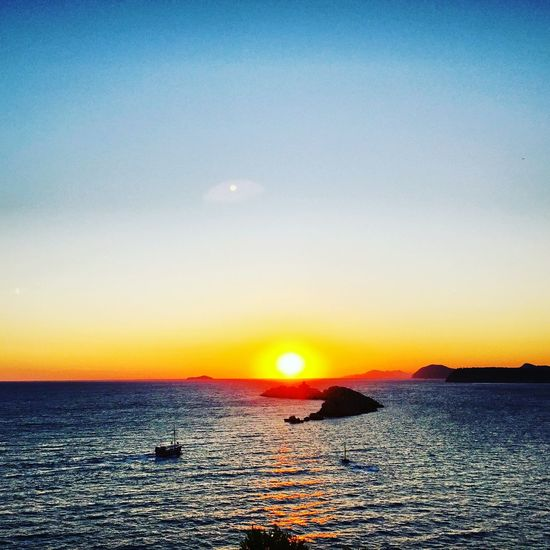 Croacia Dubrovnik, Croatia Sea Sunset Beauty In Nature Scenics Nature Tranquility Sky Horizon Over Water Outdoors No People Water Sun Moon Day Astronomy