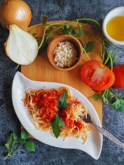 High angle view of spaghetti bolognaise in plate on table