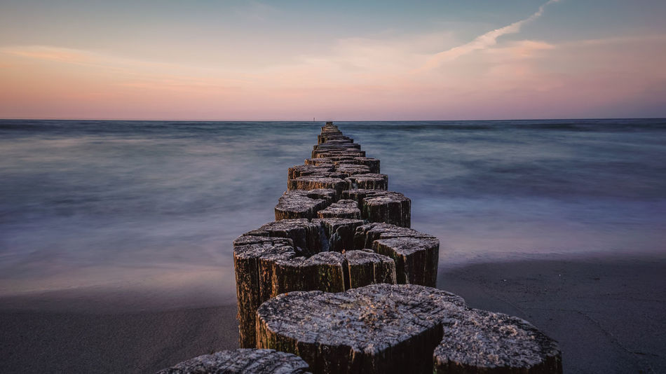 The Sun goes down, the sky is epic Baltic Sea Ostseeküste Beach Beauty In Nature Cloud - Sky Horizon Horizon Over Water Idyllic Land Landscape_photography Nature No People Outdoors Rock Rock - Object Scenics - Nature Sea Sky Solid Sunset Tranquil Scene Tranquility Water Waterfront Wooden Post