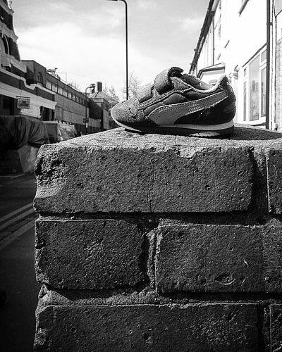 Shoe Lost Lost And Found Kids Shoes Wall On The Street On The Wall Alone Alone In The City  Blackandwhite Photography Textures