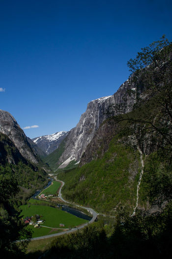 A typical valley in western Norway Norway In A Nutshell Stalheim Western Norway Beauty In Nature Blue Clear Sky Day Landscape Mountain Mountain Range Nature Norway Nature Outdoors Scenic Beauty Scenics Sky Tourism Tree Water
