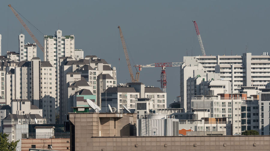 View of the typical high-rise apartment blocks and construction cranes in Seoul, South Korea Accommodation Appartament Block Architecture ASIA Business Finance And Industry City Cityscape Crane District Districts Dwelling Exterior Horizontal House Multistorey Outdoors Residential  Seoul Sky South Korea