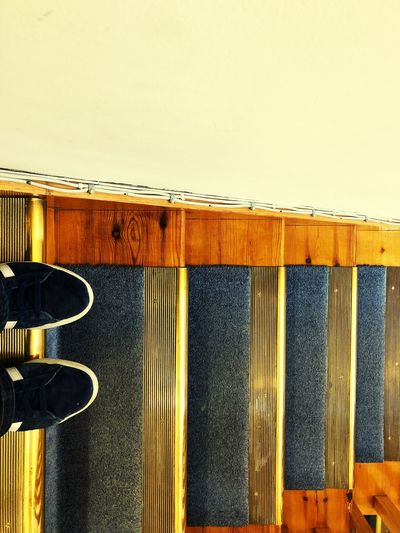 Trainers Pair Of Feet. What Now Where To Go Direction Looking Down Down On The Edge Stairs EyeEm Selects Yellow No People Day Hanging Built Structure Close-up