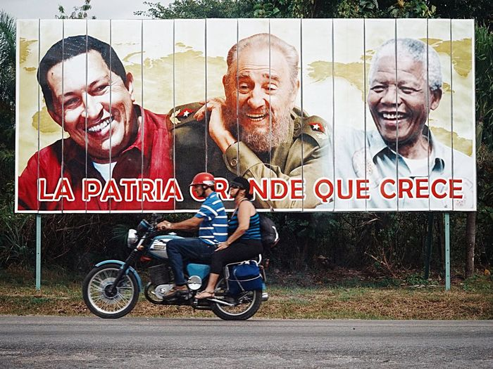 seen in Cuba, 2015. two riding a motorcycle from former East Germany. A Nation that did not grow anymore ( la Patria grande que crece = the great nation that grows) Poster Mandela Castro Chavez  On The Way Socialism Travel Travel Photography Cuba Berlin Adventure Club Streetphotography Found On The Roll The Week Of Eyeem Street Photography Street Berlin Photographer Bestoftheday Motorcycles East Germany Showcase July EyeEm Diversity The Traveler - 2018 EyeEm Awards