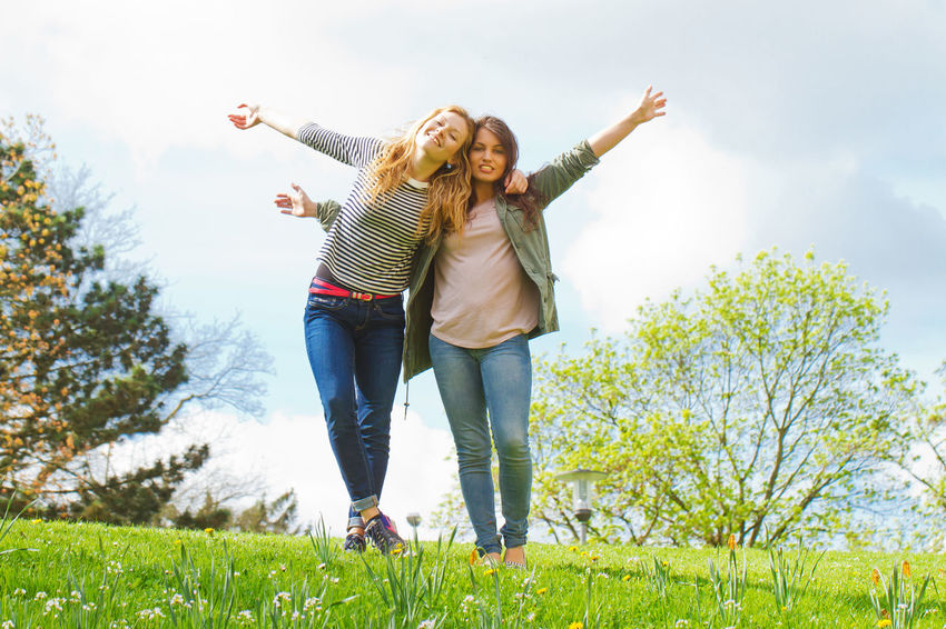 Happy friends Dancing Freedom Silly Woman Arms Raised Carefree Enjoying Life Feeling Good Friendship Fun Girl Girls Grass Happiness Leisure Leisure Activity Lifestyles Nature People Smiling Teenager Togetherness Two People Women Young Adult