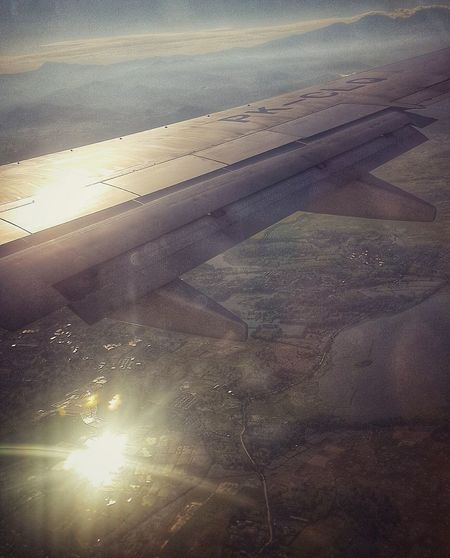 Reflection on the land From An Airplane Window AMPt - Escape Open Edit AMPt Community Hello World Travelling