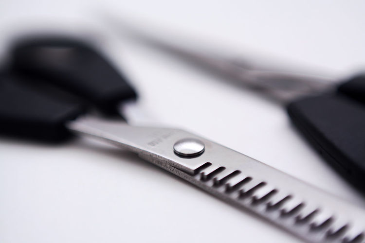Stainless steel thinning scissor in art soft focus Thinning Hair Stylish Barber Sign Blurred Soft Focus Advertisement Icon Logo Symbol Idea Creative Perspective Concepts Conceptual Business Commercial Website EyeEm Best Shots Abstract Studio Shot Work Tool Close-up Hand Tool Scissors Barber Cutting Hair Sharp Combing Hair Care Hair Salon Tool