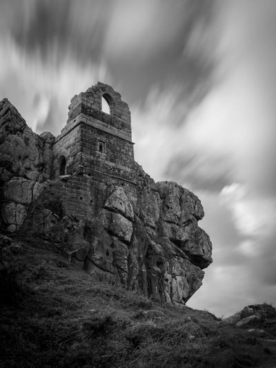 On a very cloudy and windy day in April, I had the luck of getting the right condition to capture the long exposure moment. Sky History The Past Architecture Cloud - Sky Built Structure Ancient Low Angle View Nature Solid Old Ruin Day No People Rock Rock - Object Travel Destinations Old Travel Mountain Land Outdoors Ruined Ancient Civilization Deterioration Archaeology Blackandwhite Cornwall Uk England My Best Photo The Architect - 2019 EyeEm Awards