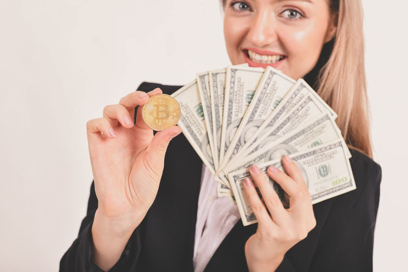 Adult Beautiful Woman Business Currency Cut Out Finance Front View Hairstyle Happiness Holding Indoors  Lifestyles One Person Paper Currency Portrait Savings Smiling Studio Shot Wealth White Background Women Young Women