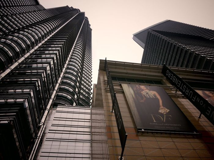 EyeEmNewHere Low Angle View Skyscraper Architecture City Modern Built Structure Building Exterior Day Travel Destinations Outdoors No People Sky Suria KLCC Malaysia Malaysianstreet City Mix Yourself A Good Time The Week On EyeEm Berlin Love Clear Sky Your Ticket To Europe Building Modern Love