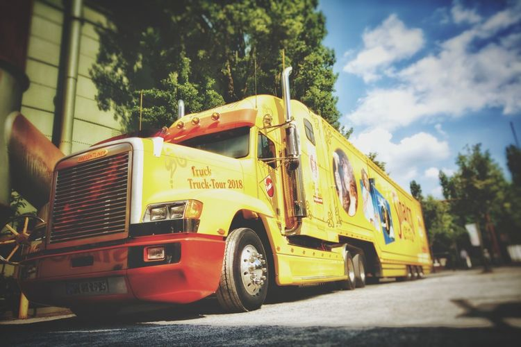 Tranportation Light And Shadow Truck Long Vehicle Sky And Clouds Low Angle View Tree Yellow Land Vehicle Sky