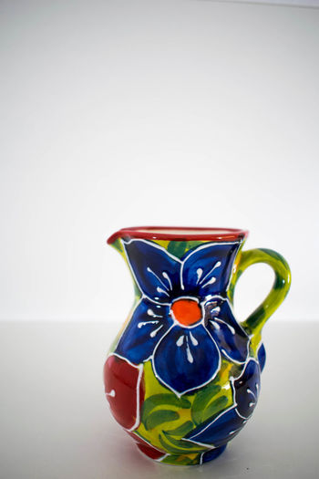 Pottery Passion Pouring Ceramic Ceramic Art Ceramics Close-up Floral Pattern Gravy Bowl Indoors  Jug Jug Of Clay Jug Of Water Jug Of Wine Multi Colored No People Pitcher Pottery Pottery Art Serving Food And Drinks Spanish Ceramics Still Life Studio Shot Table Ware White Background White Background,
