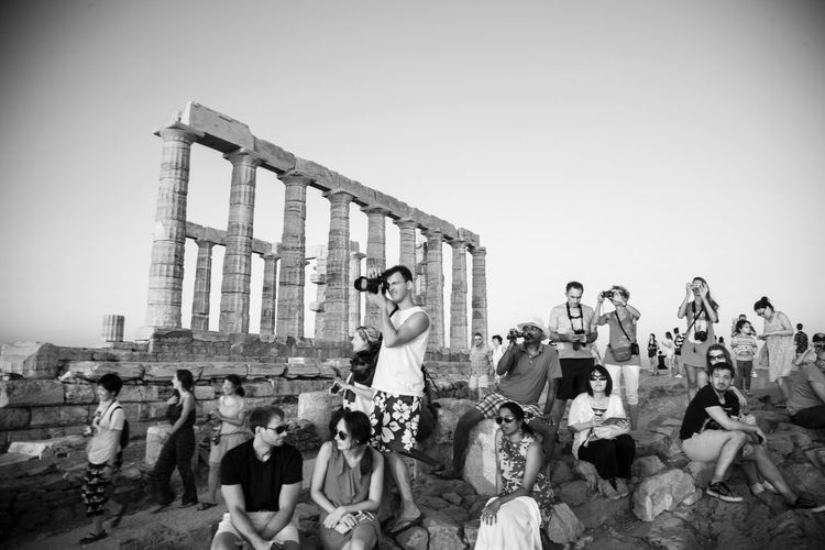 Aegean Sea Cameras Columns Culture Historic Place Monument People Sea Sunset Temple Of Poseidon Tourists Watching
