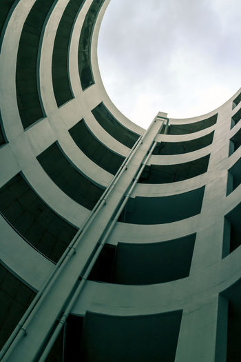 Abstract geometry perspective of spiral ramp slope for parking space at a building for background
