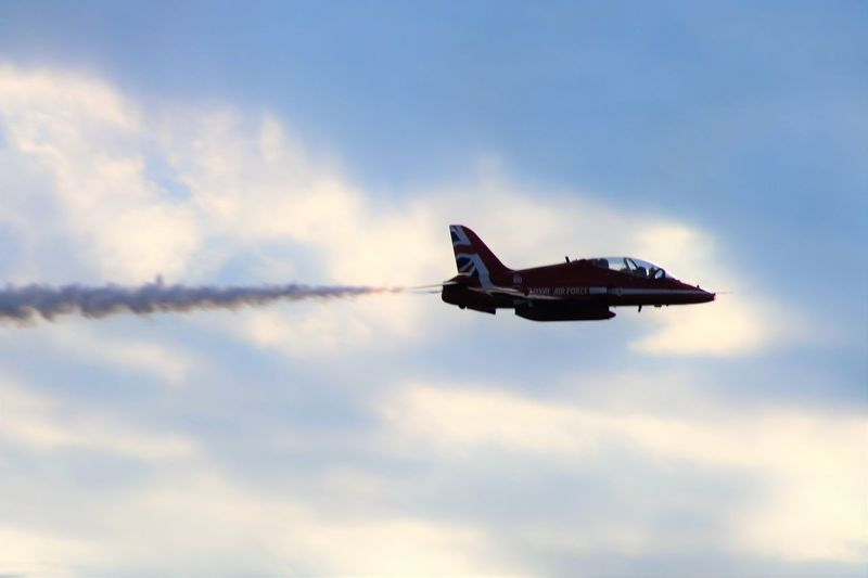 Air Display  Red Arrows Air Display Aerospace Industry Air Vehicle Airplane Airshow Cloud - Sky Day Flying Journey Leaving Low Angle View Mid-air Mode Of Transportation Motion Nature No People on the move Outdoors Plane Private Airplane Sky Speed Transportation Travel Vapor Trail