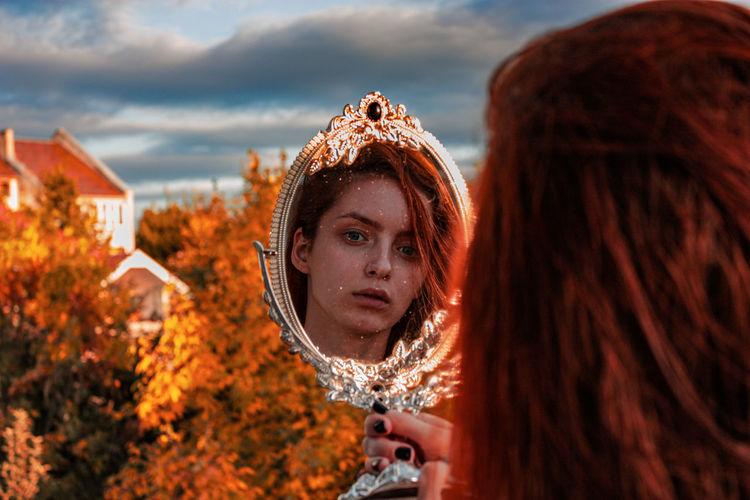 Portrait of woman against sky during autumn