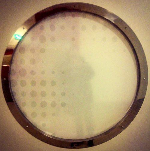 Mirrored window, taken while walking around town centre. Circle Window Mirrored Circular Window Town Centre Manchester