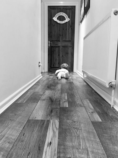 Baby crawling down hallway of her home Wood - Material Home Home Interior Baby Crawling Baby Girl Crawling Baby Hallway House Built Structure Architecture Indoors  Day Long Goodbye Black And White Friday