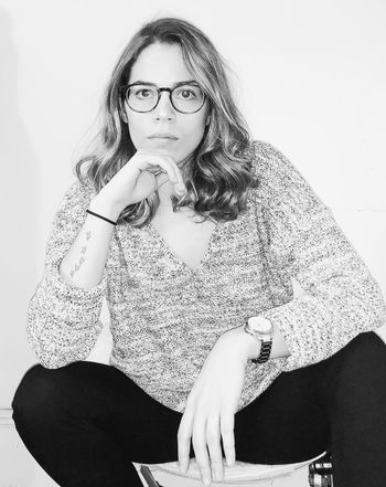 forty-one. B & W By Yeli Self Portrait Black And White Minimalism One Person Indoors  Eyeglasses  Lifestyles Looking At Camera Sitting Front View Real People Women Young Adult Leisure Activity Glasses Portrait Casual Clothing Hairstyle Wall - Building Feature