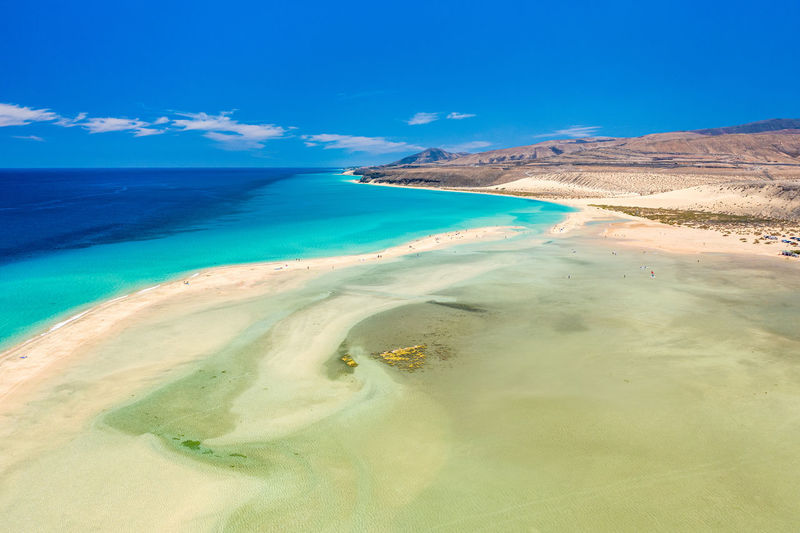 Sotavento beach lagoon, Fuerteventura Beach Sea Fuerteventura Nature Coastline Landscape Tourism Sand Blue Ocean Coast View Summer Travel Water Sky Canary Islands Island Aerial Vacation Destination SPAIN Outdoors Beautiful Holidays Atlantic Touristic Spanish Shore Bay Lagoon Tropical Turquoise Paradise Sotavento Desert Landscape Crystal Jandia Exotic Scenery Daytime Postcard Above Sunny Famous Canarias Epic Amazing No People Idyllic The Great Outdoors - 2019 EyeEm Awards My Best Photo