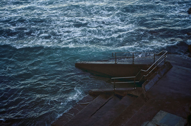 Bondi Beach Aquatic Sport Architecture Beauty In Nature Bondi Beach Salt Water Pool Bondi Beach, Sidney, Australia Day Flowing Water High Angle View Motion Nature Nautical Vessel No People Outdoors Power In Nature Railing Scenics - Nature Sea Sport Staircase Water Wave Wood - Material Capture Tomorrow