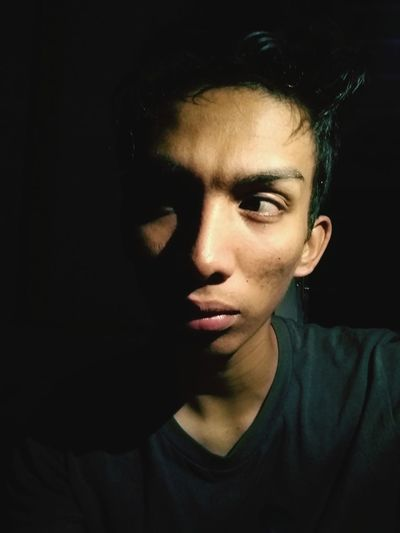 Alone in the DARK Portrait Serious Young Adult Human Face Headshot Dark Black Background Only Men One Man Only Concentration Chiaroscuro  Black Color