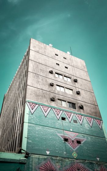 Premium Collection EyeEm Selects Architecture Built Structure Low Angle View Sky Building Exterior Building No People Water Clear Sky Old Turquoise Colored Wall - Building Feature Text Outdoors Tower Modern Nature Day Western Script Weathered Autumn Mood EyeEmNewHere