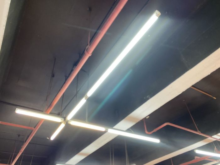 Low angle view of light trails on ceiling