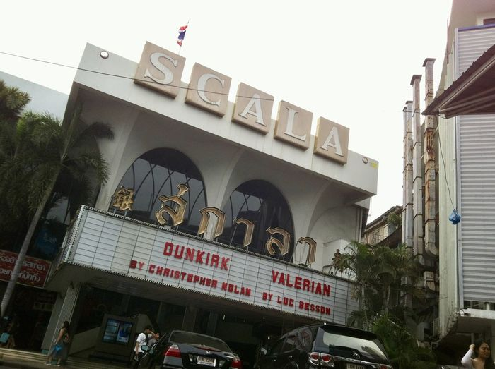The oldest single-screen movie hall in Bangkok - SCALA Theatre Historical Building Movie Hall The Only One Theater Architectural Conservation Architecture Building Exterior Built Structure City Communication Conserved Building Day Large Group Of People Low Angle View Men Oldest Outdoors People Real People Text Unique
