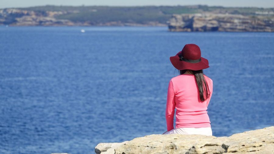 enjoy your own company.. Candid Travel Tranquility Blue Sunny Travel Destinations Australia Sydney Happiness EyeEmNewHere EyeEm Nature Lover EyeEmBestPics EyeEm Best Shots EyeEm Gallery Hanging Out Pink Water Sea Beach Red Full Length Rear View Women Summer Horizon Over Water Shore Calm Coastline Escapism Alone
