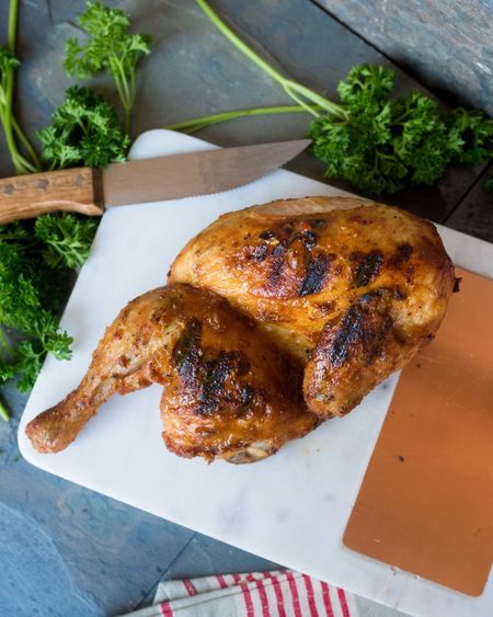High Angle View Of Roast Chicken In Cutting Board