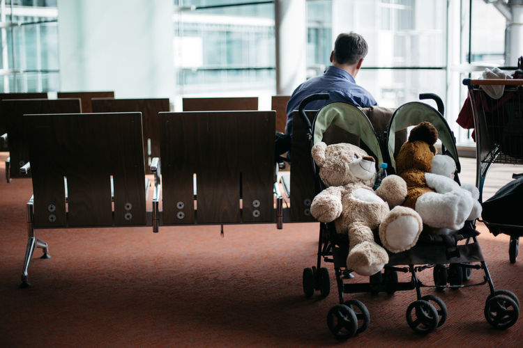 Teddy bears in baby stroller at airport