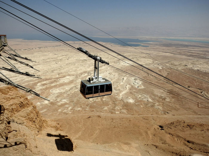 Masada And The Dead Sea Arid Climate Beauty In Nature Cable Clear Sky Connection Day Hanging Judean Desert Landscape Masada Mode Of Transport Nature No People Outdoors Overhead Cable Car Scenics Sky Technology Transportation Been There.