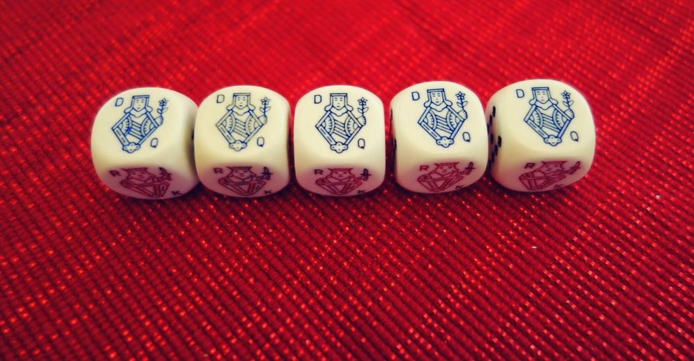 High angle view of poker dices on table