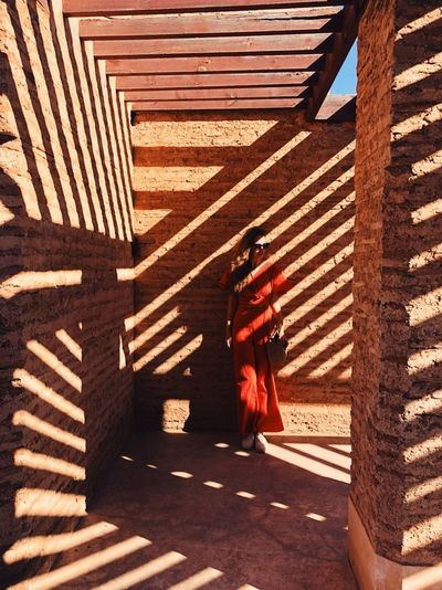 Shadow cutting the sun Geometry El Badi Marrakech Marrakesh Morocco Shadow Sunlight Real People Pattern Nature Day Leisure Activity Striped Women Focus On Shadow 17.62°