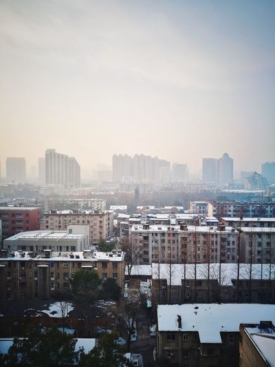 Cityscape Street Photography Huawei P9 Photos Travel Tranquility Tranquil Scene Snow Hefei, China Hefei Skyscraper Cityscape Urban Skyline City Building Exterior Architecture Sky Downtown District No People Residential Building Day Winter Outdoors