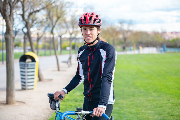 Portrait of smiling man riding bicycle