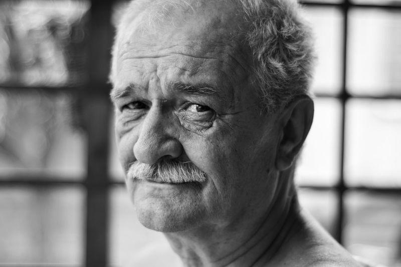 Close-Up Portrait Of Smiling Mature Man