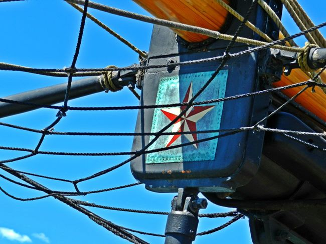 Nautical Star Blue Cable Close-up Day Low Angle View Metal Nautical Nautical Star Nautical Theme Net No People Outdoors Part Of Part Of Ship Pirate Ship Pole Power Line  Red Rope Ship Ships Mast Sky Star Tall Ship White