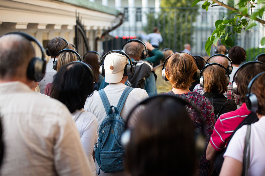 Headphones Tourist Attraction  Adult Architecture Casual Clothing City City Life Crowd Day Group Group Of People Large Group Of People Lifestyles Men Outdoors Real People Rear View Selective Focus Spectator Standing Street Tourism Women